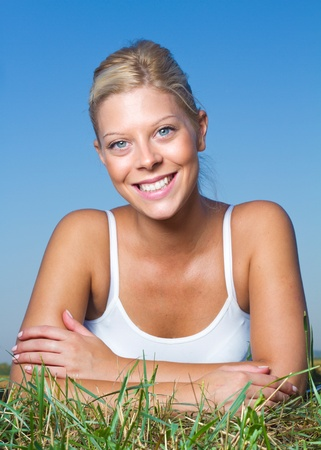 Beautiful young female smiling outdoors Stock Photo - 13686872