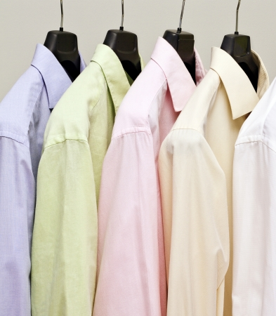 Multicolor men shirts on hanger  Studio shot  Stock Photo