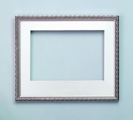 Silver decorative frame with passpartout on wall  Toned image  Stock Photo