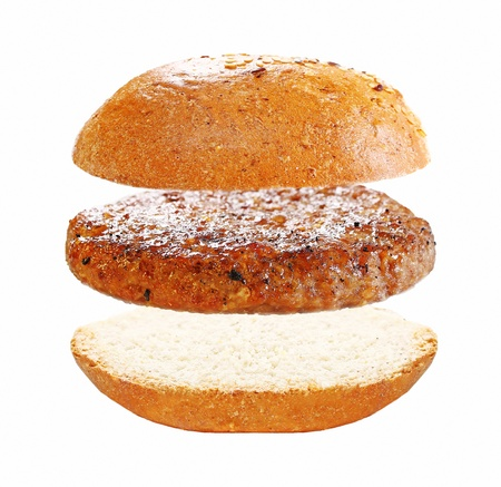 Three basic elements of domestic burger and a home-made bun isolated on white