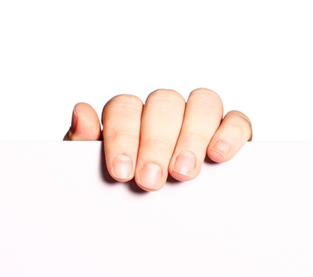 Human hand holding a white poster board isolated on white background Stock Photo - 16603064