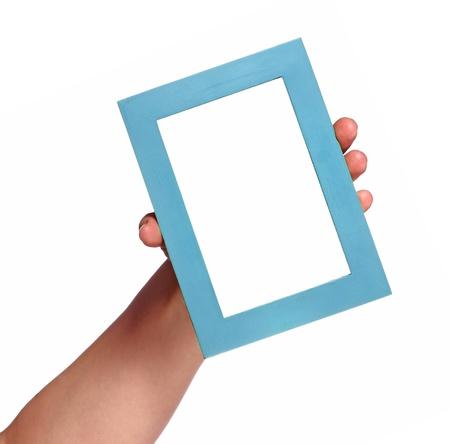 Human hand showing empty photo frame. Studio shot isolated on white Stock Photo - 16613307