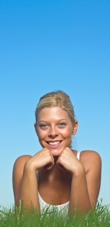 Beautiful blue-eyed blonde girl smiling on a sunny summer day  Stock Photo - 16874406