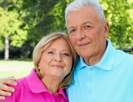 Senior couple posing hugged outdoors. See more of same models Stock Photo