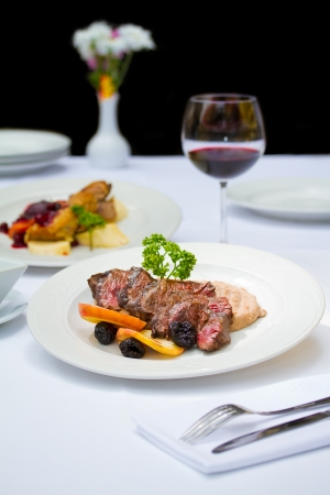 venison: Fine dining restaurants are full service restaurants with specific dedicated meal courses Stock Photo