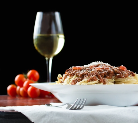 wine sauce: Ragu alla bolognese is a complex sauce which involves a variety of cooking techniques, including sweating, sautéing and braising. Stock Photo