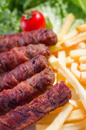 kabab: Kebab (kebap, kabab, kebob, kabob, kibob, kebhav, or kephav; also pinchos (puertorican), Ćevapi, or Ćevapčići) is a wide variety of skewered meals originating in the Middle East