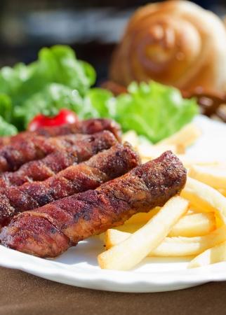kebob: Kebab (kebap, kabab, kebob, kabob, kibob, kebhav, or kephav, also pinchos  is a wide variety of skewered meals originating in the Middle East Stock Photo