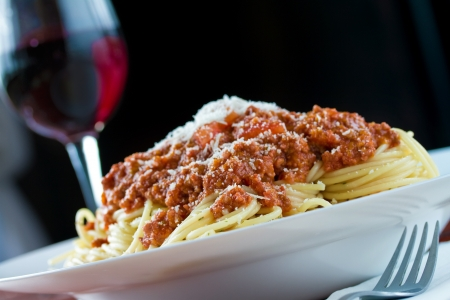 Ragu alla bolognese is a complex sauce which involves a variety of cooking techniques, including sweating, sautéing and braising. Stock Photo - 20979225