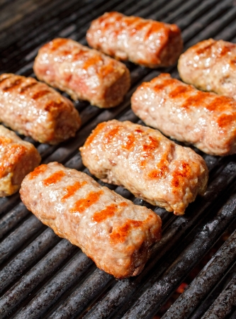 Grilling some cevapcici on pro grill. Fresh and tasty look