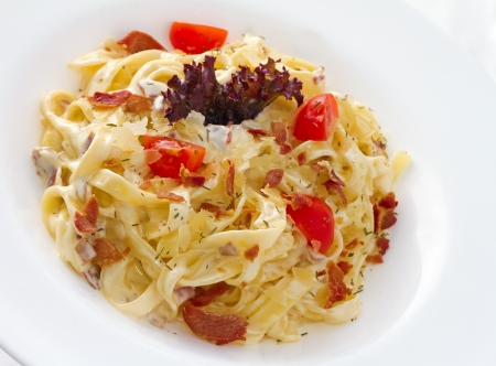 Carbonara is an Italian pasta dish  and more specifically to Rome, based on eggs, cheese (Pecorino Romano or Parmigiano-Reggiano), bacon (guanciale or pancetta), and black pepper.