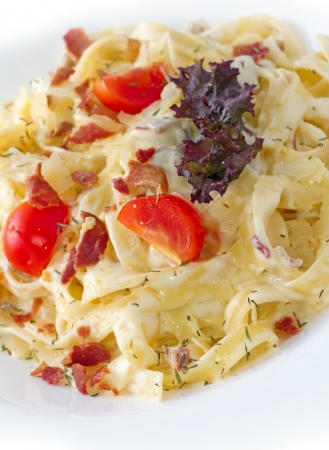 specifically: Carbonara is an Italian pasta dish  and more specifically to Rome, based on eggs, cheese (Pecorino Romano or Parmigiano-Reggiano), bacon (guanciale or pancetta), and black pepper.