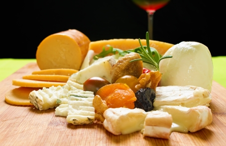 antipasto platter: Variety of dairy products  Choice of cheese on wooden board and wine