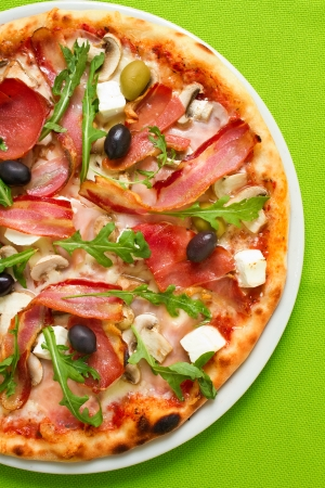 Overhead shot of tasty pizza with plenty of fresh toppings Stock Photo