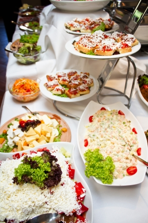 dinner cruise: Catering is the business of providing food service at a remote site or a site such as a hotel, public house  pub , or other location  Stock Photo