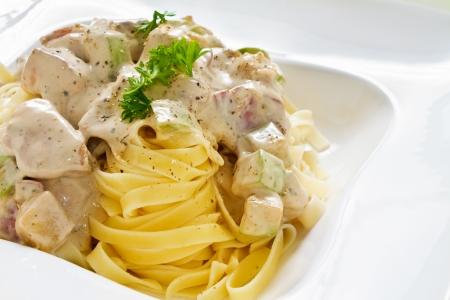 alfredo: Tagliatelle pasta with white chicken zucchini sauce with nice copy space
