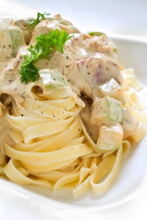 alfredo: Tagliatelle pasta with white chicken zucchini sauce  Studio shot