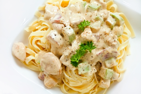 Fettuccine Alfredo with white chicken zucchini sauce with nice copy space  Overhead shot Stock Photo