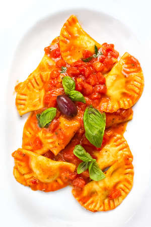 Ravioli are a traditional type of Italian filled pasta. Stock Photo - 23115152