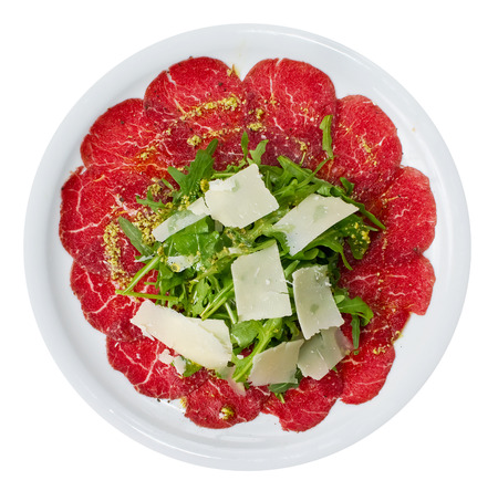 Carpaccio is a dish of raw meat  (such as beef, veal or venison), thinly sliced or pounded thin and served mainly as an appetizer.