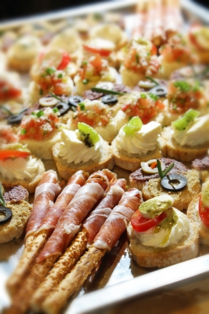 Variety of finger food on catering event  Shalloe focus photo