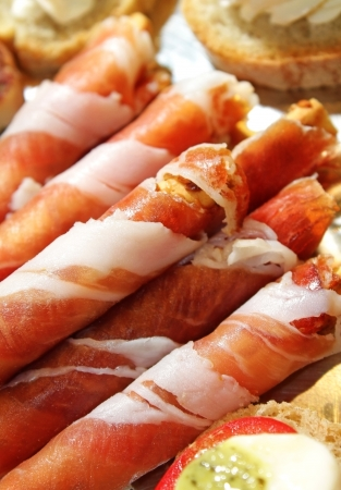 prosciutto: Prosciutto or Parma ham is a dry-cured ham that is thinly sliced and served uncooked
