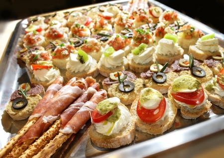 Variety of finger food on catering event. Shalloe focus photo