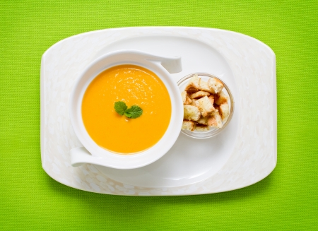 potage: Freshly made pumpkin soup served on green with croutons