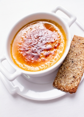 brulee: Coffee cream brulee served with cracker on white