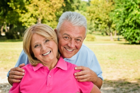 Senior couple enjoy posing outdoors feeling healthy Stock Photo
