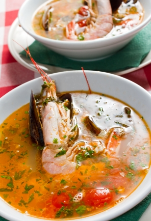 Seafood soups with shrimp and clams  Restaurant shot  photo