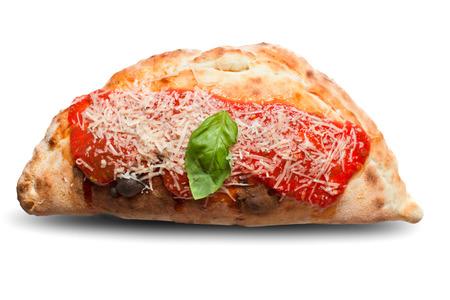 shreded: Isolated studio shot of tasty freshly baked italian closed pizza called panzarotti