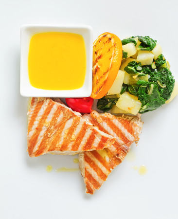 potato tuna: Grilled Tuna steaks served with boiled potato and lemon sauce, garnished with tomato and orange