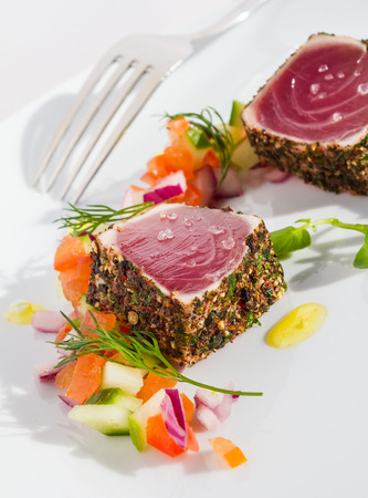 seared: Pepper coated and lightly seared raw tuna chunks served with finely chopped vegetable salad and sprinkled with sea salt