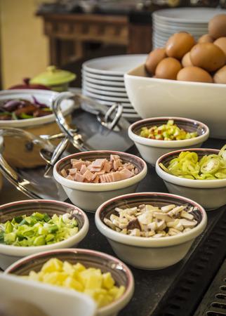 dinner menu: Set of bowls for custom omelette at hotel breakfast buffet Stock Photo
