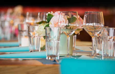 Celebration table set and ready for guests. Mixed flowers bouquet  Stock Photo