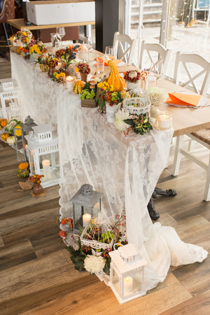Christmas themed wedding table for bride and groom Stock Photo - 70731007