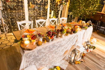 vintage furniture: Christmas themed wedding table for bride and groom