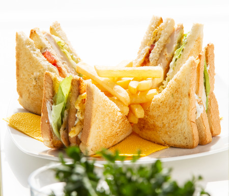 Club Sandwich with fries on sunshine, arranged and splited Stock Photo - 70942610