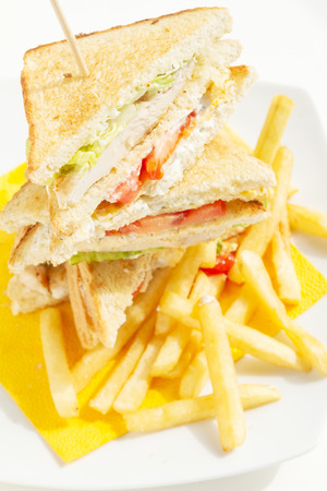 Club Sandwich with fries on sunshine, arranged and splited Stock Photo - 70940731