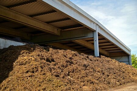 Composted soil pile at the compost plant. Compost big mountain outdoor ecological recycle industry environment fertilizer. Ecology background