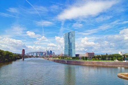 View of the main river with the headquarters of ECB and the skyline of Frankfurt. European Central Bank and Skyscraper buildings in Germany with blue sky background. Business and finance concept