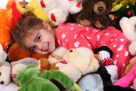 Little girl swimming in her toys Reklamní fotografie