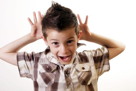 fooling: 6 year old boy fooling around Stock Photo