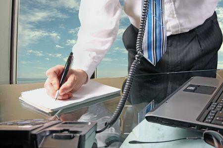 businessmen taking note Reklamní fotografie