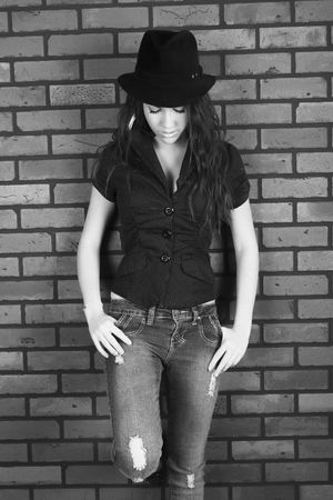 black and white portrait of a beautifull girl wearing a hat