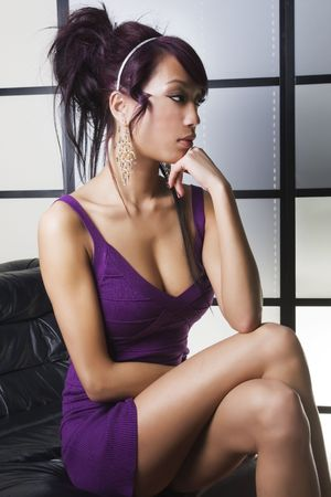 thinking woman: beautiful chinese girl sitting Stock Photo