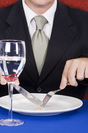 consummation: businessmen on a diet eating vitamin