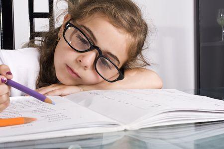 little girl tyerie of doing her homework Stock Photo - 5362303