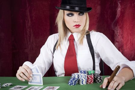 hold'em: beautiful blond playing card at the casino
